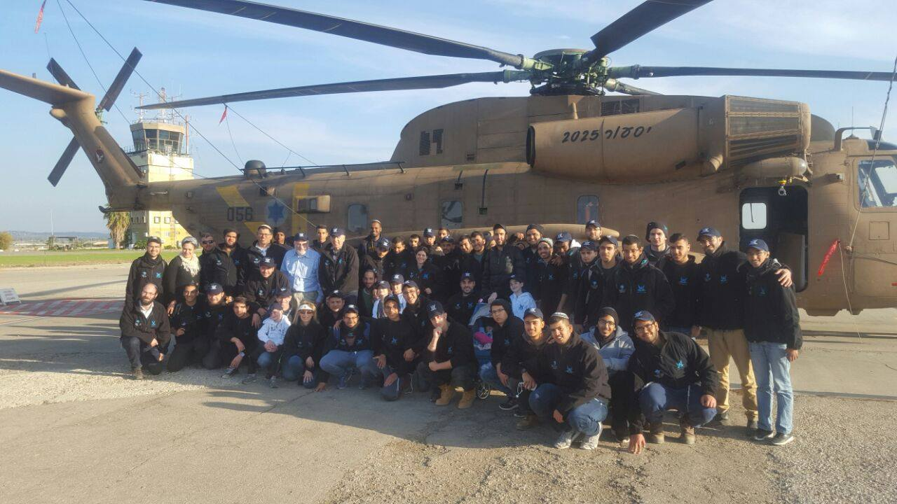 group photo with helicopter